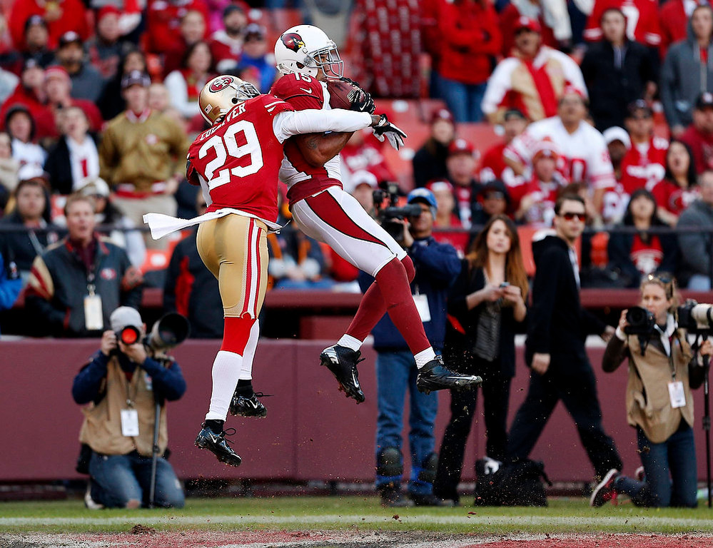 . Arizona Cardinals wide receiver Michael Floyd (R) makes a leaping catch to score a touchdown ahead of San Francisco 49ers cornerback Chris Culliver (29) during the fourth quarter of their NFL football game in San Francisco, California December 30, 2012.   REUTERS/Beck Diefenbach   (UNITED STATES - Tags: SPORT FOOTBALL TPX IMAGES OF THE DAY)