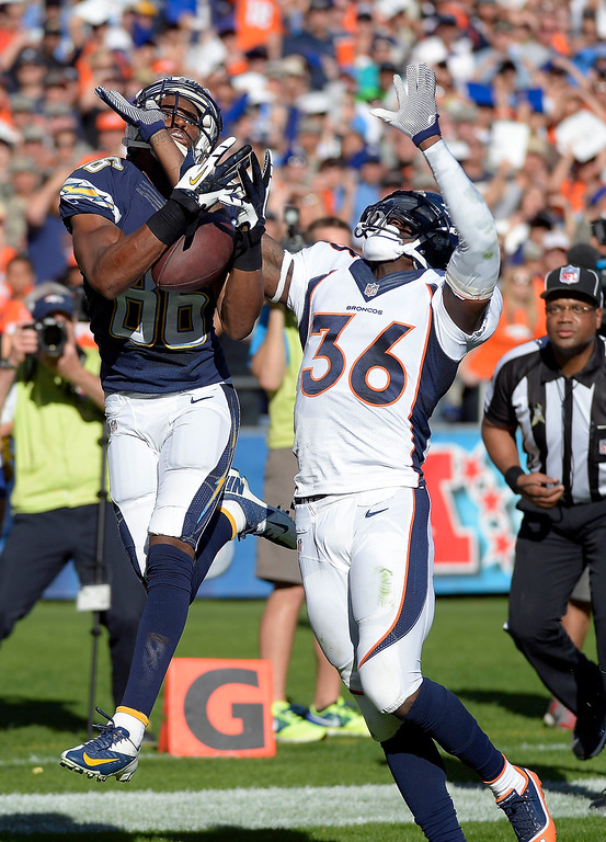 . Denver Broncos cornerback Kayvon Webster (36) breaks up a pass intended for San Diego Chargers wide receiver Vincent Brown (86) in the end zone during the second quarter at Qualcomm Stadium. (Photo by John Leyba/The Denver Post)