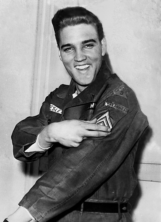 . American rock and roll singer Elvis Presley smiles after he is promoted to army sergeant at the U.S. Army Unit\'s maneuver headquarters in Grafenwoehr, Germany, Feb. 11, 1960.  Presley is promoted to the NCO rank in the 1st Battalion, 32d Armor Regiment, 3d Armored Division.  (AP Photo)