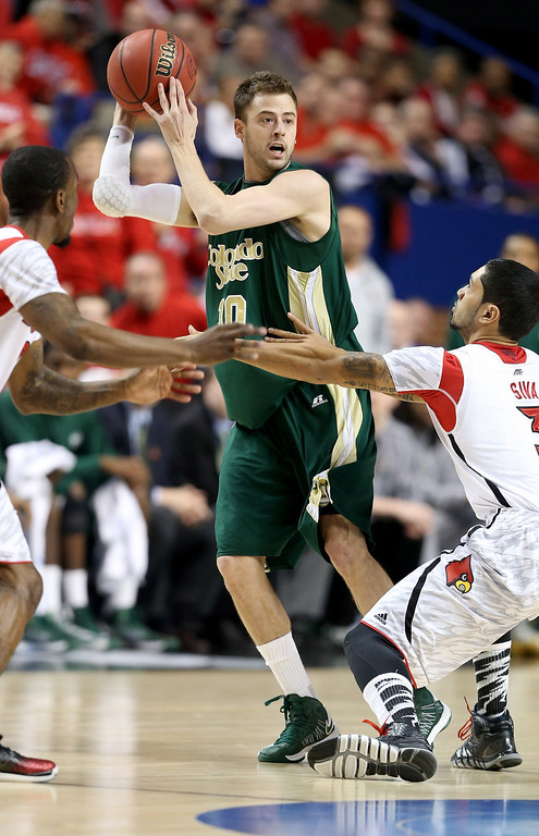 . LEXINGTON, KY - MARCH 23: Wes Eikmeier #10 of the Colorado State Rams handles the ball against Peyton Siva #3 of the Louisville Cardinals in the first half during the third round of the 2013 NCAA Men\'s Basketball Tournament at Rupp Arena on March 23, 2013 in Lexington, Kentucky.  (Photo by Andy Lyons/Getty Images)