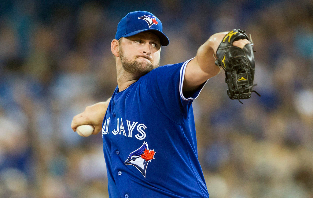 . Blue Jays starter Todd Redmond works against the Twins during the first inning. (AP Photo/The Canadian Press, Chris Young)