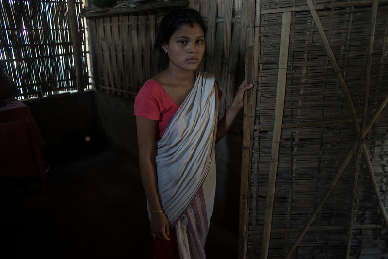 Dhemanji, Assam, India August,2014:   Janamani Das (14) married and has a one month old baby seen at her home in Simen Koi Bata village.  She lives alone as her husband works in southern state of Kerala.   Series on early marriages in Assam, India for Al Jazeera America.       Photo:  Sami Siva