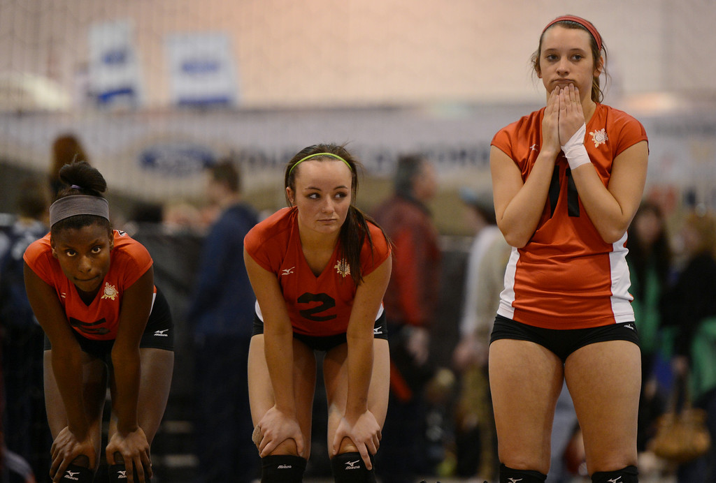 . DENVER, CO. - MARCH 02: Darion Bucknor, Baylee Bates and Faith Whiteley of Texas Image, Grand Prairie, TX, watch their game against the Evolution Volleyball Club, Alexandria, VA, during the  Colorado Crossroads National Qualifier volleyball tournament at the Colorado Convention Center in Denver, CO March 02, 2013. The event, held over two weekends,  is one of nine national tournaments that lead up to the USA Junior National Girls\' Volleyball Championships. Close to 700 teams will play on 89 courts through the weekend. (Photo By Craig F. Walker/The Denver Post)