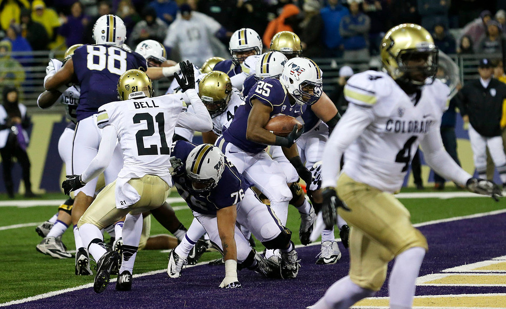 . Washington tailback Bishop Sankey (25) runs for a a touchdown against Colorado in the first half of an NCAA college football game on Saturday, Nov. 9, 2013, in Seattle. (AP Photo/Ted S. Warren)