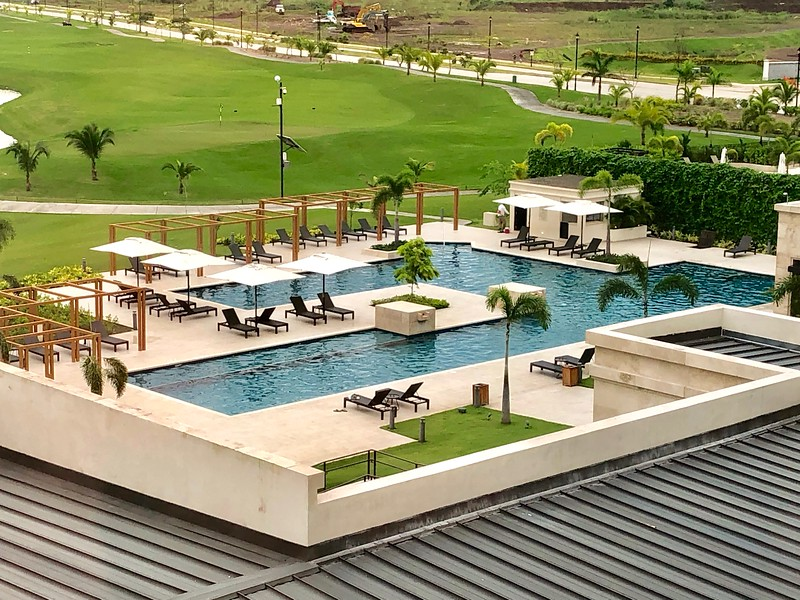 An swimming pool next to a golf club in Panama.