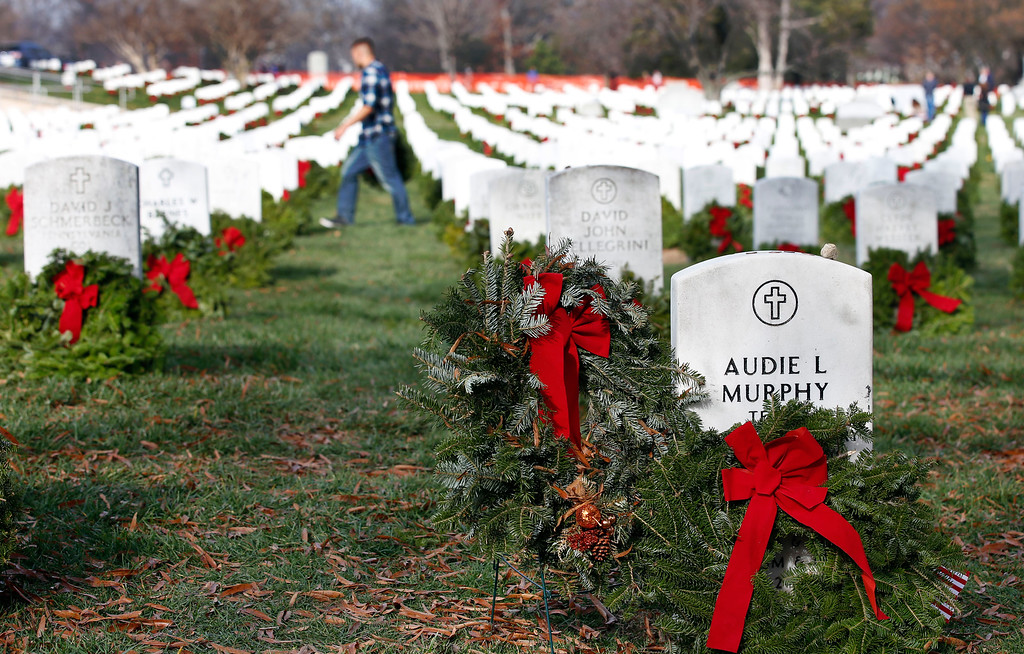 . The grave of Medal of Honor recipient Audie Murphy is adorned with a wreath as part of Wreaths Across America at Arlington National Cemetery, Saturday, Dec. 12, 2015 in Arlington, Va. By the end of WWII, Murphy had become one of the nation\'s most-decorated soldier, earning an unparalleled 28 medals. Organizers estimated that volunteers placed 240,815 wreaths at Arlington. (AP Photo/Alex Brandon)
