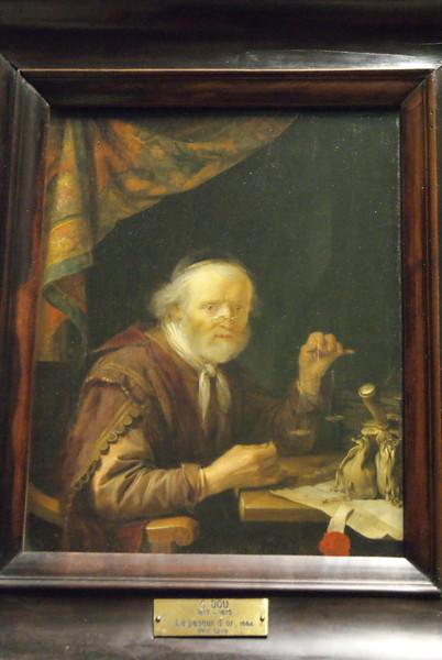 A man weighing gold by Gerard Dou