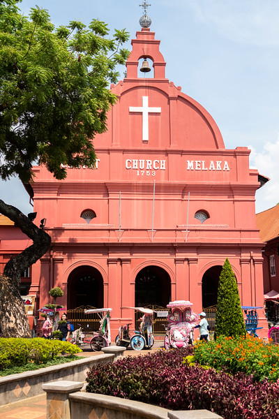 Gardens in front of the 18th century Anglican Christ Church in Malacca, Malaysia. Malacca is a UNESCO World Heritage City and was an important trading center during spice trade. The city remains well preserved and showcases well preserved colonial buildings that represent the complex history of Malaysia.