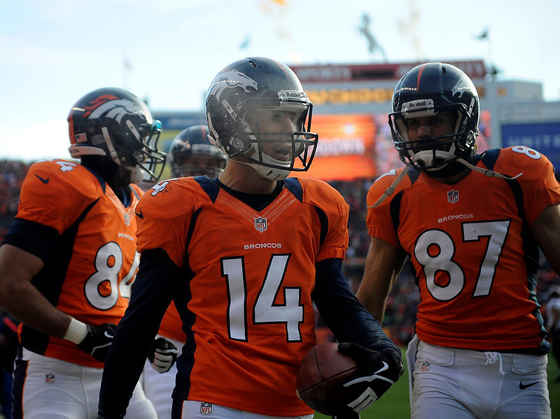 . Denver Broncos wide receiver Brandon Stokley (14) celebrates after scoring the Broncos second touchdown of the game in the first quarter.  The Denver Broncos vs Baltimore Ravens AFC Divisional playoff game at Sports Authority Field Saturday January 12, 2013. (Photo by Hyoung Chang,/The Denver Post)