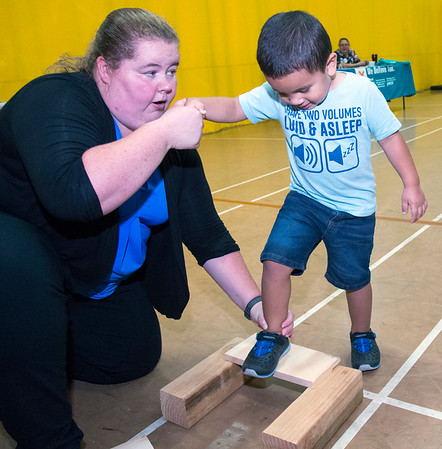 08/22/19 Wesley Bunnell | Staff The New Britain YWCA held an open house on Thursday August 22, 2019 to showcase the programs and benefits for prospective members by having them visit scavenger hunt stations each with a different theme. Darcy Needham, a Tang So Do instructor, teaches Noah Lopez the proper technique to break a board with his foot.