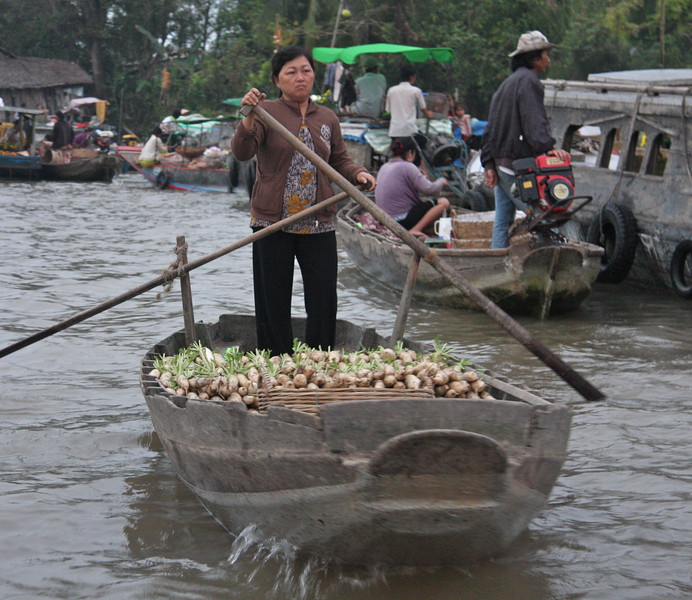 The incredible floating markets in the Mekong Delta.  WE got up at 4 am to get a good tour of them as they start early and are over by 8am or so. The boats just float around the river trading whatever they are carrying with others.