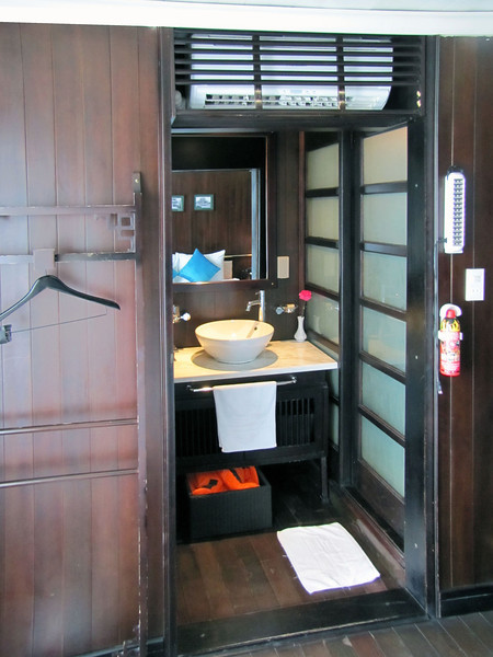 09-Aircon, mirror, basin, life vest, shower on right, WC on left (behind the hanger).