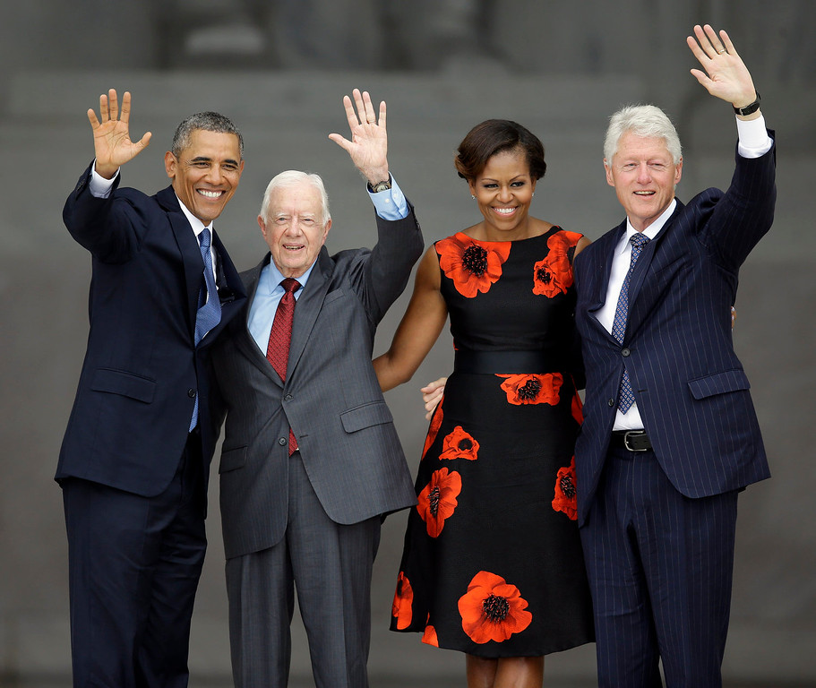 """. President Barack Obama, former President Jimmy Cater, first lady Michelle Obama and former President Bill Clinton wave at the end of  the Let Freedom Ring ceremony at the Lincoln Memorial in Washington, Wednesday, Aug. 28, 2013, to commemorate the 50th anniversary of the 1963 March on Washington for Jobs and Freedom. It was 50 years ago today when Martin Luther King Jr. delivered his \""""I Have a Dream\"""" speech from the steps of the memorial. (AP Photo/Carolyn Kaster)"""