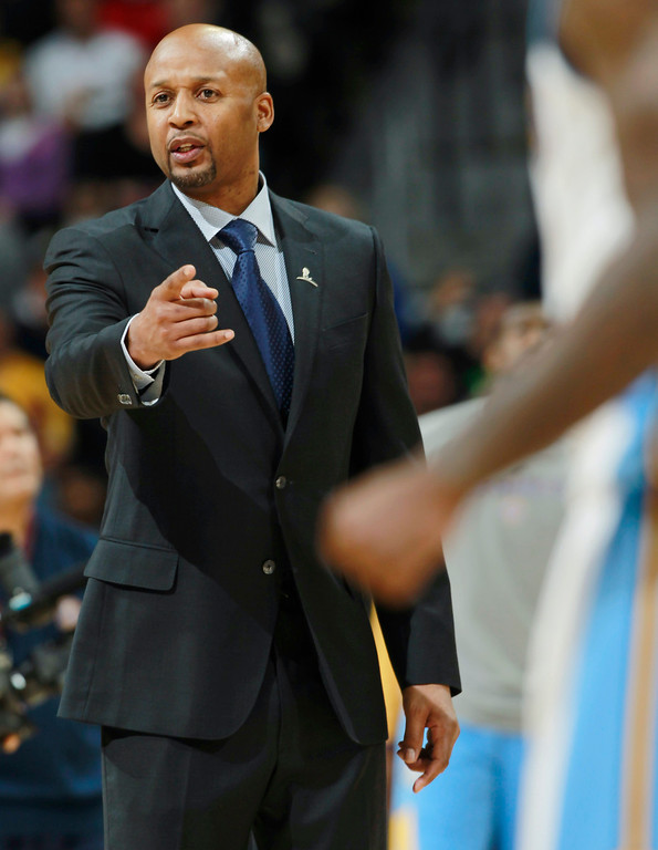 . Denver Nuggets head coach Brian Shaw argues with officials for a foul to be called against the Los Angeles Lakers in the fourth quarter of the Nuggets\' 134-126 victory in an NBA basketball game in Denver on Friday, March 7, 2014. (AP Photo/David Zalubowski)