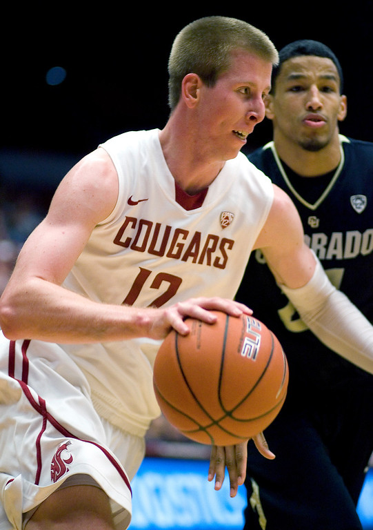 . Washington State forward Brock Motum (12) drives against Colorado forward Andre Roberson (21) during the first half of an NCAA college basketball game Saturday, Jan. 19, 2013, in Pullman, Wash. (AP Photo/Dean Hare)