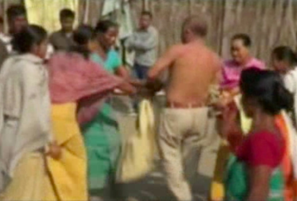 . In this image taken from video obtained from Network 1 News and Information Syndicate (NNIS), which has been authenticated based on its contents and other AP reporting, Bikram Singh Brahma, center, a leader of India\'s ruling Congress party, is slapped by a woman in the village of Santipur, India, on Thursday, Jan. 3, 2013. Police said Brahma was visiting the village of Santipur on the Bhutan border when he entered a woman\'s house and raped her at 2 a.m. In a sign that attitudes might be changing since the rape of a 23-year-old woman in New Delhi, who died of severe internal injuries over the weekend, police have arrested Brahma. (AP Photo/NNIS)