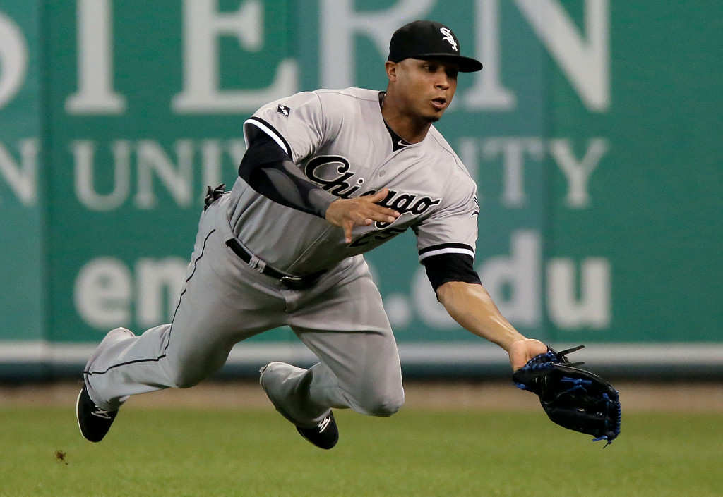 . Chicago White Sox\'s Moises Sierra makes a diving catch of a fly ball hit by Detroit Tigers\' Rajai Davis during the ninth inning of a baseball game Tuesday, July 29, 2014, in Detroit. (AP Photo/Duane Burleson)
