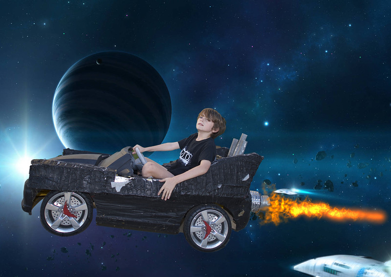 OIiver in his Bat Mobile