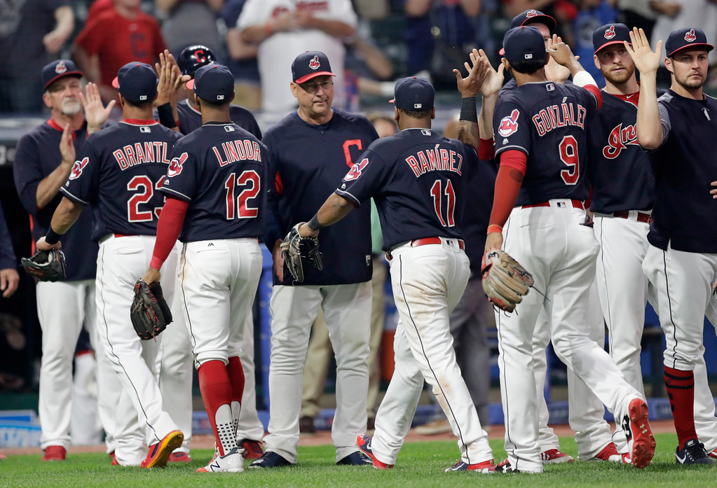 . Cleveland Indians manager Terry Francona, center, congratulates teammates after the Indians defeated the Chicago White Sox 6-3 in a baseball game, Tuesday, June 19, 2018, in Cleveland. (AP Photo/Tony Dejak)