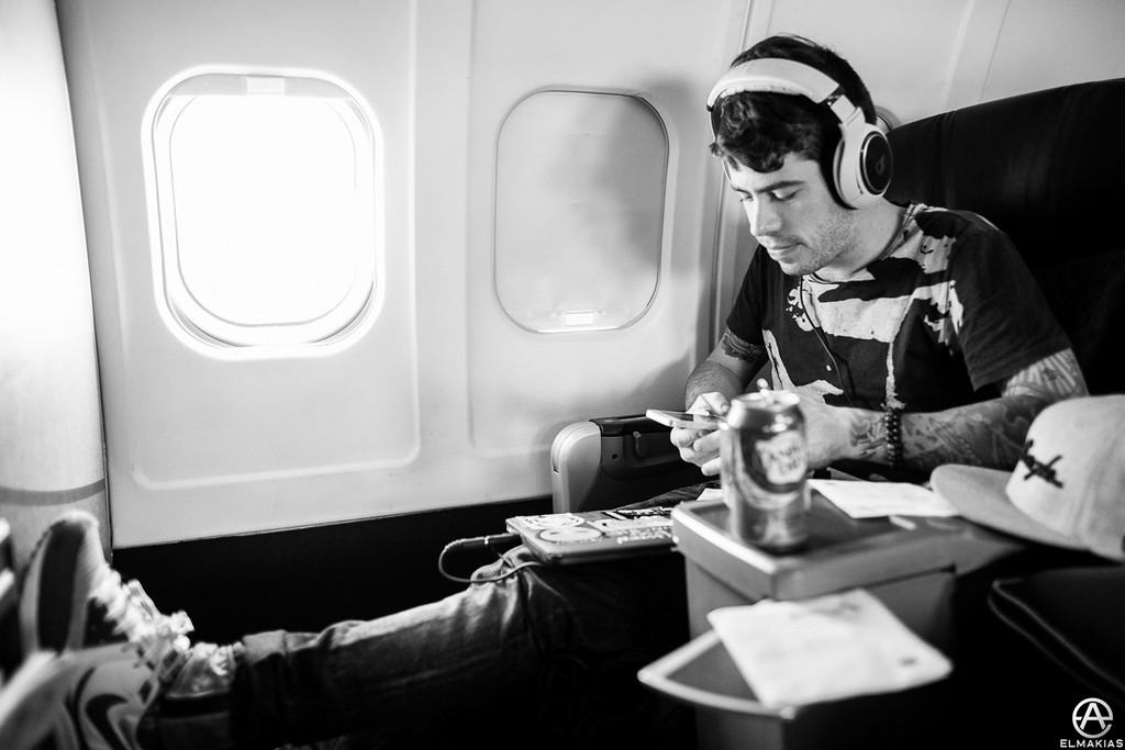 Alex in full chill mode. He once hated flying, he still does, but at least he chillin' - A Day To Remember by Adam Elmakias