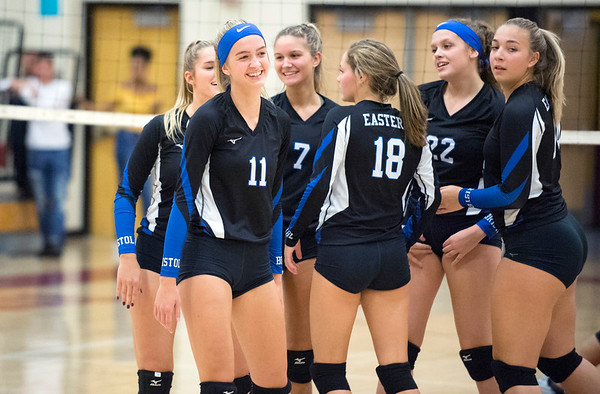 09/16/19 Wesley Bunnell | StaffrrBristol Eastern's Ryley Plourde (11), Zoe Lowe (7), Leah Chipman (18), Hannah Webber (22) and teammates celebrate a point during a game against New Britain on Monday night at New Britain High School.