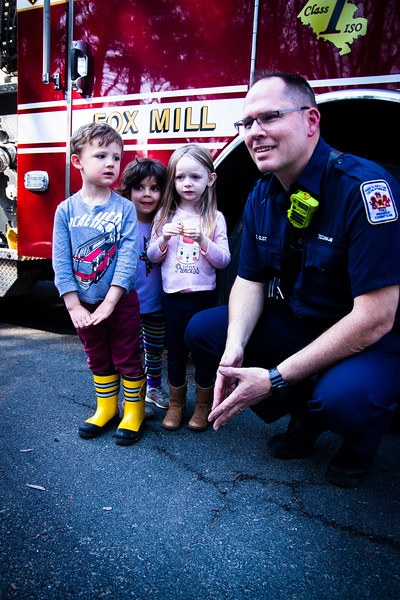 August looks at fire fighter with awe_March 14 2019.JPG