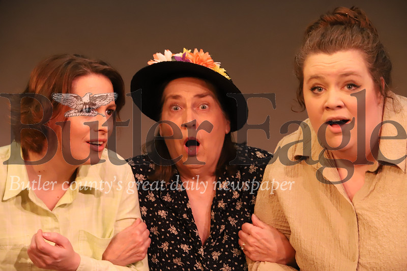 """Danielle Jacobson(left) (Middle woman to be Id'd) and Ariana O'Donnell (right) rehearse the wedding gossip scene from Butler Little Theatre's production of """"Our Town."""" Seb Foltz/Butler Eagle"""