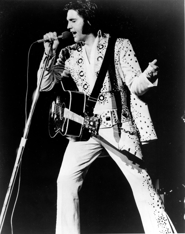 . Elvis Presley is shown performing in this undated photo at an unknown location.  (AP Photo)