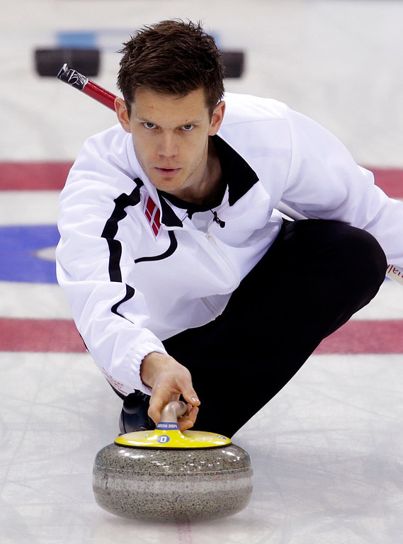 . Denmark\'s skip Rasmus Stjerne Hansen delivers a ow during men\'s curling competition against Norway at the 2014 Winter Olympics, Monday, Feb. 17, 2014, in Sochi, Russia. (AP Photo/Robert F. Bukaty)