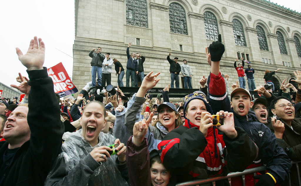 . Boston Red Sox fans cheer from the Boston Public Library during the rolling rally in Boston Saturday, Oct. 30, 2004 to celebrate the Red Sox World Series victory. (AP Photo/Elise Amendola)