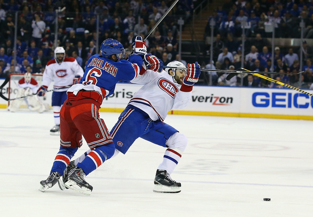 . Max Pacioretty #67 of the Montreal Canadiens is knocked off the puck by Anton Stralman #6 of the New York Rangers  in Game Three of the Eastern Conference Final during the 2014 NHL Stanley Cup Playoffs at Madison Square Garden on May 22, 2014 in New York City.  (Photo by Al Bello/Getty Images)