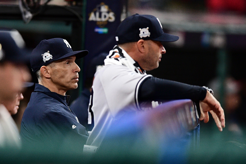 . New York Yankees manager Joe Girardi watches from the dugout during the fifth inning of Game 5 of the baseball team\'s American League Division Series against the Cleveland Indians, Wednesday, Oct. 11, 2017, in Cleveland. (AP Photo/David Dermer)