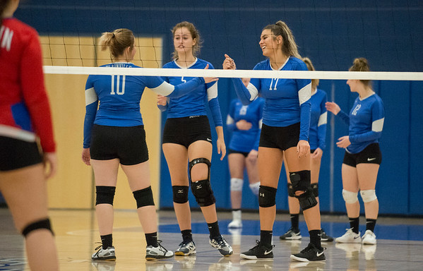10/21/19 Wesley Bunnell | StaffrrPlainville High School girls volleyball vs visiting Berlin High on Monday night. Plainville's Makayla Caron (10), Wiktoria Galazyn (5) and Katherine Tanguay (17).