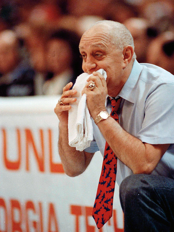 . In this April 2, 1990, file photo, UNLV coach Jerry Tarkanian chews on his towel while watching his team play Duke in the championship game of the NCAA college basketball Final Four in Denver.  (AP Photo/Ed Reinke, FIle)