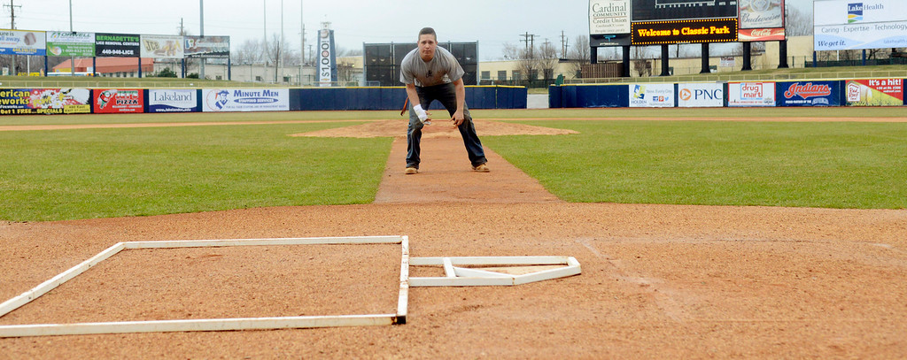. Maribeth Joeright/MJoeright@News-Herald.com<p> Grounds keeper Mike Cervella makes sure the batters box is properly aligned with home plate at Classic Park in preparation for the home opener between the Captains and the Lansing Lugnuts, April 4, 2014.