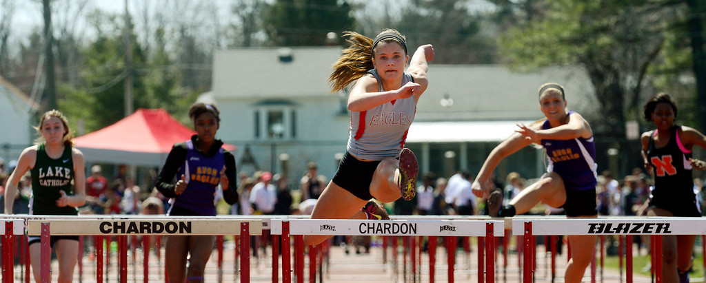 . Maribeth Joeright/MJoeright@News-Herald.com<p> Geneva\'s Ally Thompson easily won the girls 100 meter hurdles during the Hilltopper Invitational at Chardon High School. The Geneva girls won the team title in the meet.