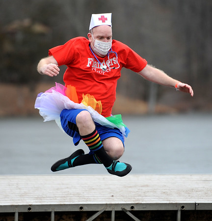 1/19/2019 Mike Orazzi | Staff Matt Koska during the 14th annual Sloper Plunge at Camp Slopers pond Saturday in Southington.