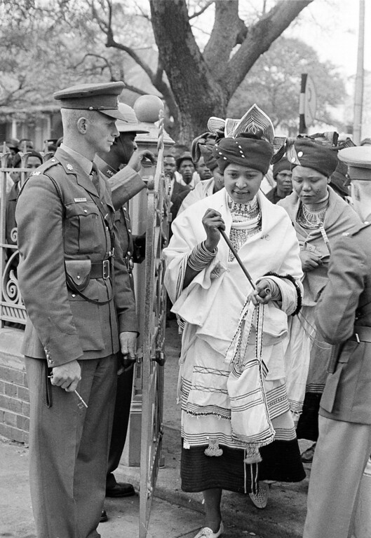 . Winnie Mandela, wife of the African National Congress (ANC) leader Nelson Mandela, wears a traditional dress as she and two other women attend her husband\'s trial in Pretoria, South Africa, Oct. 22, 1962.   Nelson Mandela pleaded not guilty in a special regional court to charges of incitement and leaving South Africa illegally.  (AP Photo)
