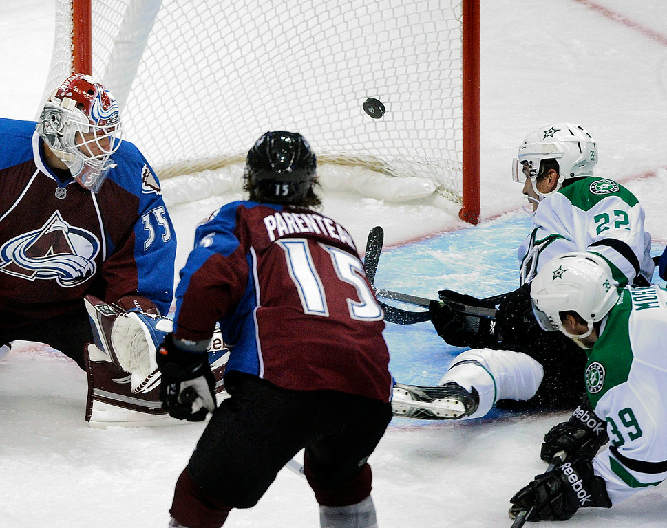 . Dallas center Colton Sceviour (22) deflected a shot past Colorado goaltender J.S. Giguere (35) in the second period for a goal. The Colorado Avalanche hosted the Dallas Stars at the Pepsi Center Tuesday night, September 24, 2013. Photo By Karl Gehring/The Denver Post