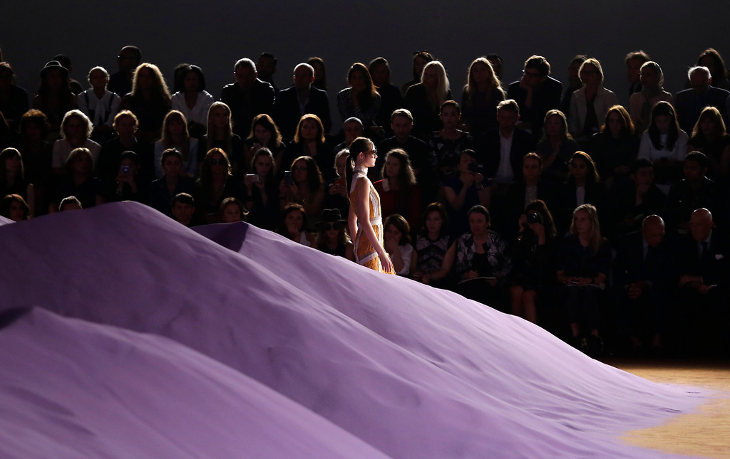 . A model wears a creation for Prada women\'s Spring Summer 2015 collection, part of the Milan Fashion Week, unveiled in Milan, Italy, Thursday, Sept. 18, 2014. (AP Photo/Antonio Calanni)