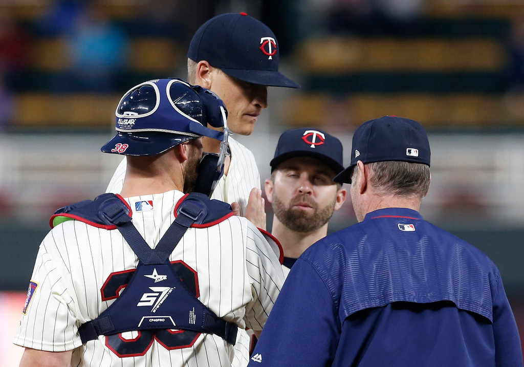 . Minnesota Twins pitcher Aaron Slegers, center top, in his major league debut, is pulled in the seventh inning against the Cleveland Indians in the second game of a baseball doubleheader Thursday, Aug. 17, 2017, in Minneapolis. The Twins won 4-2. (AP Photo/Jim Mone)