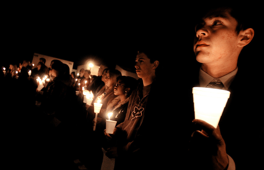 . Family and friends participate in a candlelight vigil in memory of Christopher \'Cody\' Thompson and Bodhisattva \'Bodhi\' Sherzer-Potter at the Academy of Academic Excellence in Apple Valley Thursday night January 10, 2008. (Staff file photo)