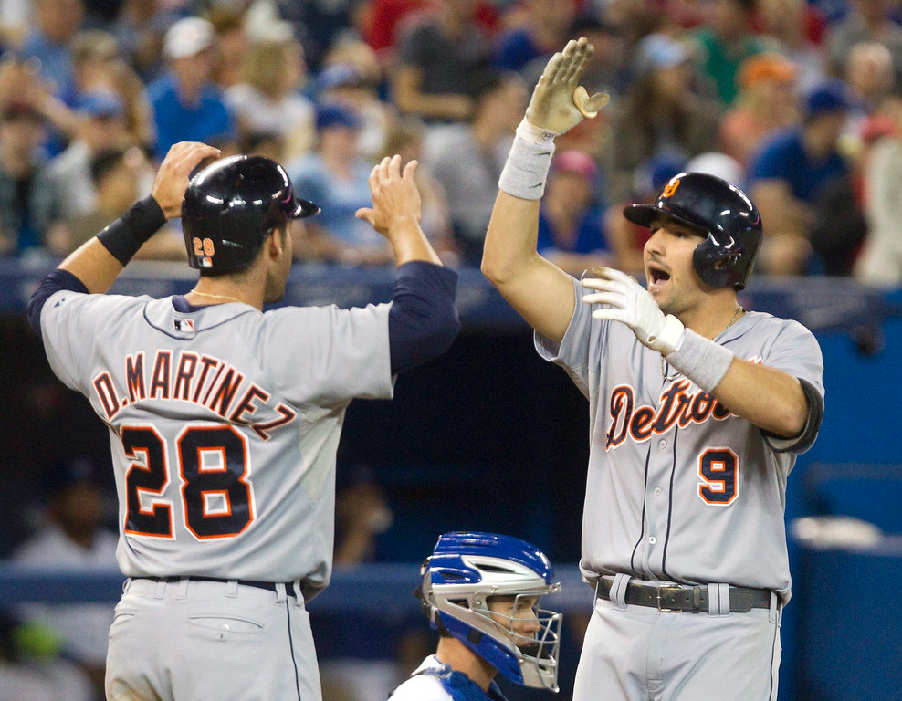 . Detroit Tigers\' Nick Castellanos celebrates with teammate J.D. Martinez at home plate after he hit a two run home against the Toronto Blue Jays during the ninth inning of a baseball game, Friday, Aug. 8, 2014 in Toronto. (AP Photo/The Canadian Press, Fred Thornhill)
