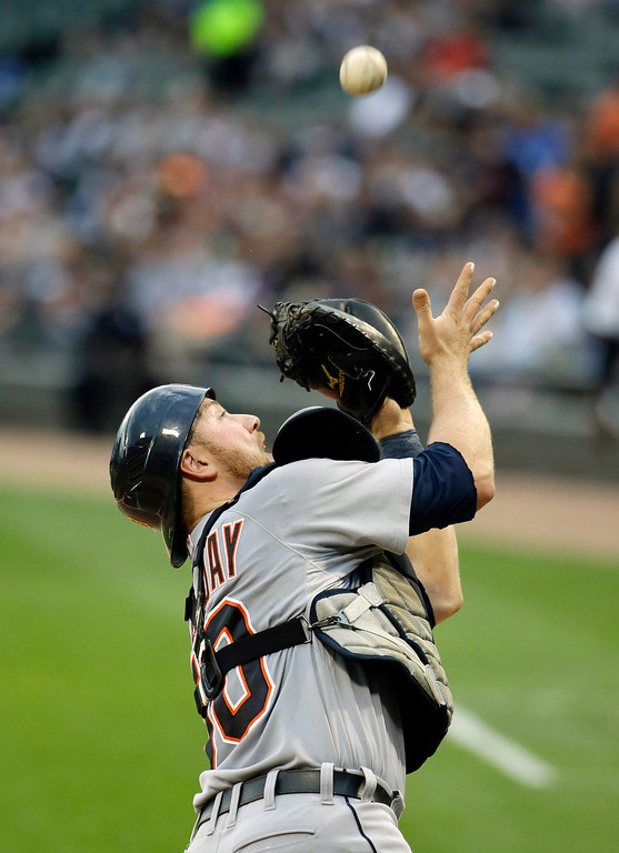 . Detroit Tigers catcher Bryan Holaday catches a foul ball hit by Chicago White Sox\'s Gordon Beckham during the first inning of a baseball game in Chicago, Thursday, June 12, 2014. (AP Photo/Nam Y. Huh)