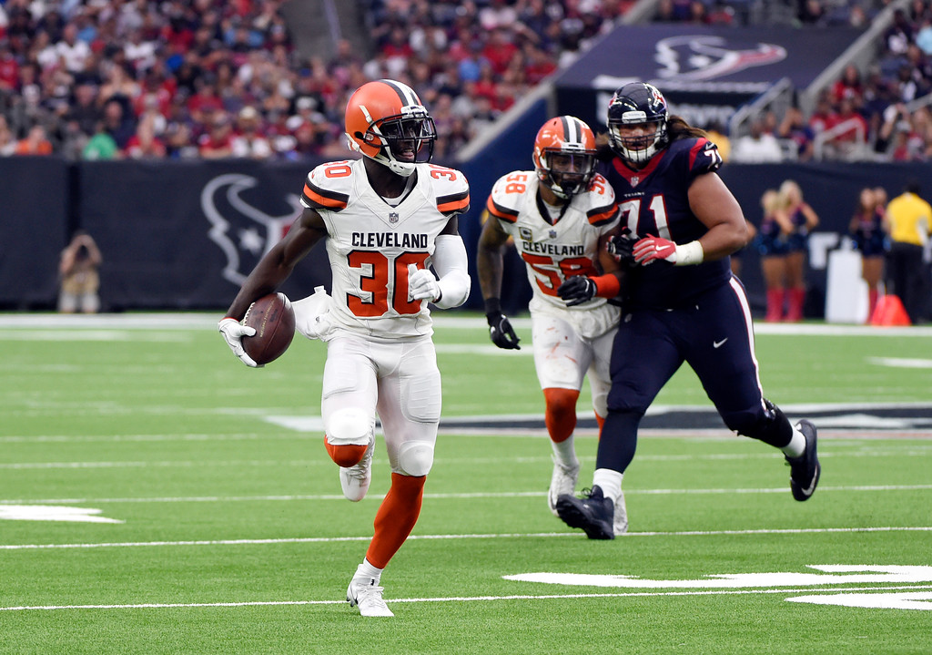 . Cleveland Browns cornerback Jason McCourty (30) returns an interception thrown by Houston Texans\' Deshaun Watson for a touchdown in the second half of an NFL football game, Saturday, Oct. 14, 2017, in Houston. (AP Photo/Eric Christian Smith)