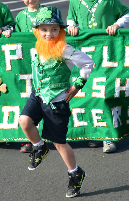 . Aiden Galvin, of Castro Valley, does an Irish dance as he leads the Powell\'s Irish Dancers during the Saint Patrick\'s Day Parade in Dublin, Calif., on Saturday, March 16, 2013. (Dan Rosenstrauch/Staff)