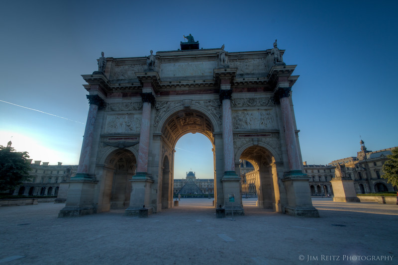 Early morning view of the Louvre, thru the Arc de Triomphe du Carousel (smaller than the big Arc de Triomphe on the Champs-Elysees)