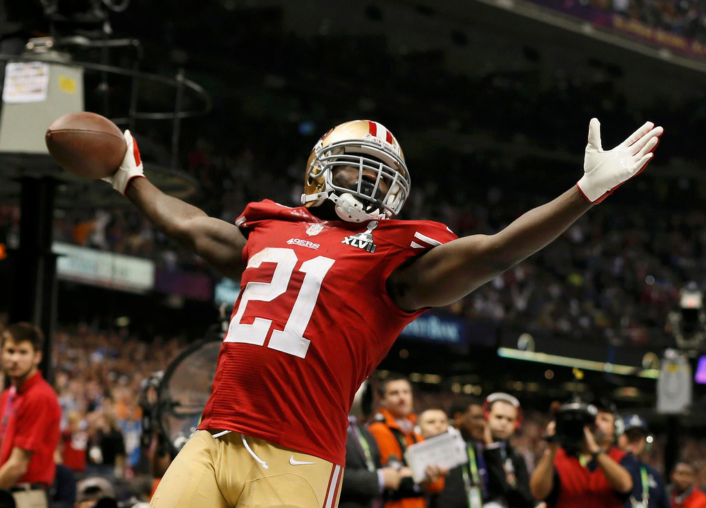. San Francisco 49ers running back Frank Gore (21) celebrates his third quarter touchdown against the Baltimore Ravens in the NFL Super Bowl XLVII football game in New Orleans, Louisiana, February 3, 2013. REUTERS/Lucy Nicholson