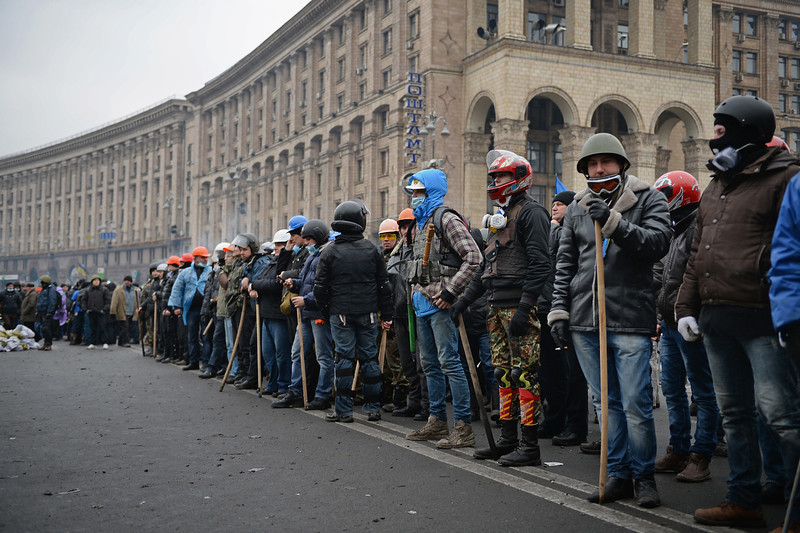 . Anti-government protesters prepare to push forward during continued clashes with police in Independence square, despite a truce agreed between the Ukrainian president and opposition leaders on February 20, 2014 in Kiev, Ukraine. After several weeks of calm, violence has again flared between police and anti-government protesters, who are calling to oust President Viktor Yanukovych over corruption and an abandoned trade agreement with the European Union.  (Photo by Jeff J Mitchell/Getty Images)
