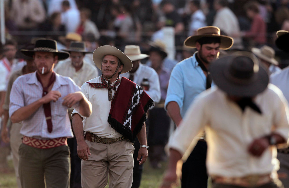 """. Gauchos leave the field after participating during the annual celebration of Criolla Week in Montevideo, March 25, 2013. Throughout Easter Week \""""gauchos\"""", the Latin American equivalent of the North American \""""cowboy\"""", from all over Uruguay and neighboring Argentina and Brazil visit Montevideo to participate in Criolla Week to win the award of best rider. The competition is held March 24 - March 30. REUTERS/Andres Stapff"""